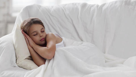 pre-teen girl sleeping at home Stock Video Footage
