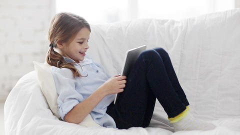 little student girl with tablet pc at home Footage