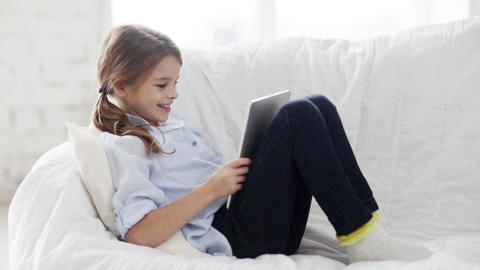 little student girl with tablet pc at home Stock Video Footage