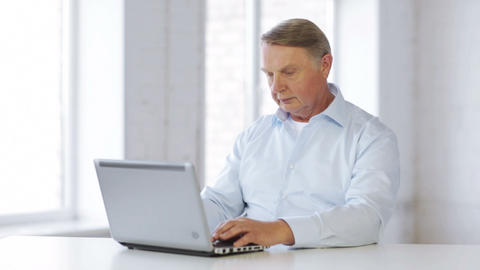 old man working with laptop at home Stock Video Footage