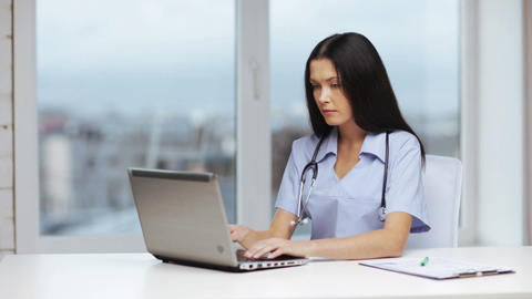 doctor or nurse with laptop pc writing prescriptio Footage