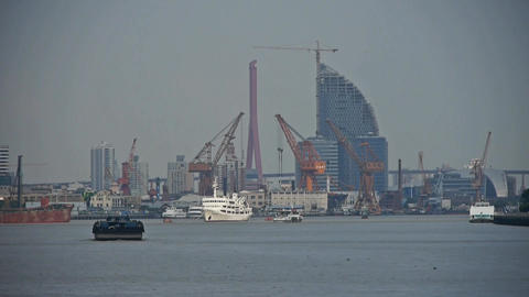 ships pass by shanghai huangpu river pier,tower cranes on... Stock Video Footage