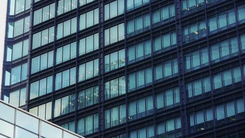 closeup skyscraper glass windows,urban morden business buildings district Animation