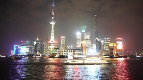 Brightly lit ship passing Shanghai at night,Pudong... Stock Video Footage
