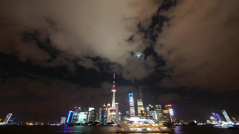 Shanghai at night,Brightly lit ship passing world... Stock Video Footage