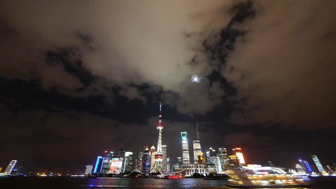 Shanghai at night,Brightly lit ship passing world economic hub,cloud in sky Animation