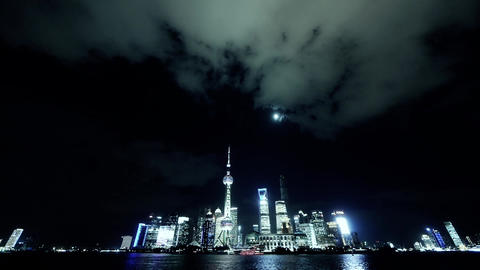 time lapse Shanghai at night,Brightly lit ship passing... Stock Video Footage