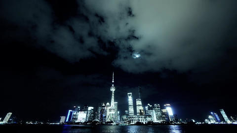 time lapse Shanghai at night,Brightly lit ship passing world business hub Animation