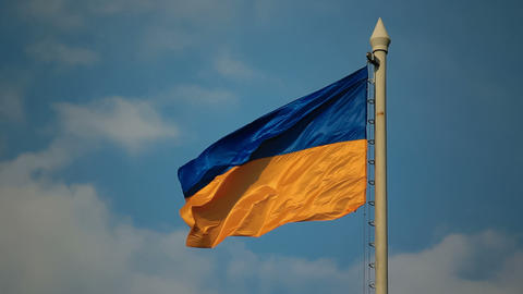 Flag of Ukraine against the background of cloudy s Stock Video Footage