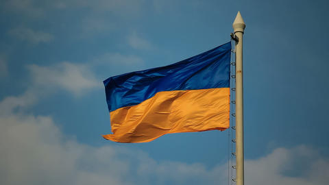 Flag Of Ukraine Against The Background Of Cloudy S stock footage