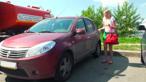 Blonde closes car Stock Video Footage