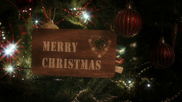 """Merry Christmas"" sign hung from a Christmas Tree Stock Video Footage"