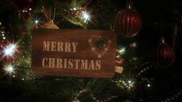 """Merry Christmas"" Sign Hung From A Christmas Tree stock footage"
