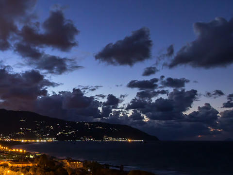 Sunset over the coast of Sicily. Patti, Italy. Tim Footage
