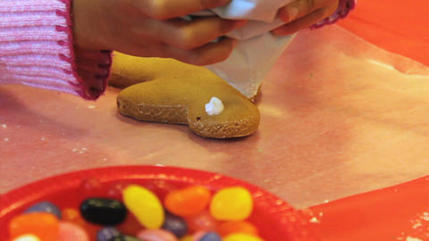 Christmas Gingerbread Man Cookie Gets Icing Stock Video Footage