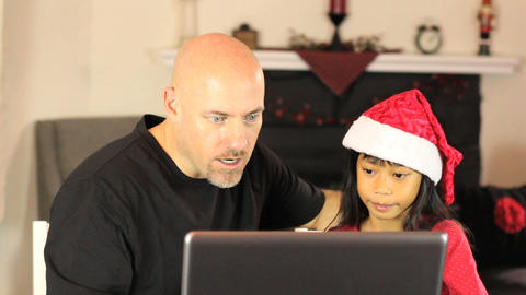 Daughter Does Online Christmas Shopping For Mommy stock footage