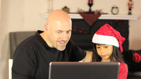 Daughter Does Online Christmas Shopping For Mommy Stock Video Footage