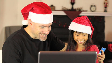Father And Daughter Buying Christmas Gifts Online Footage