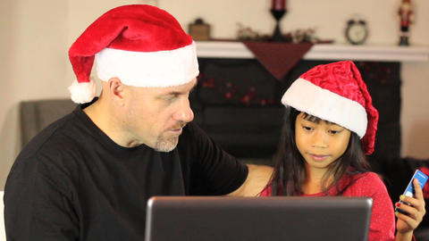 Father And Daughter Buying Christmas Gifts Online Stock Video Footage