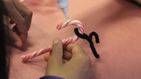 Making A Candy Cane Christmas Reindeer Footage