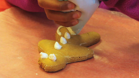 Putting Icing On Christmas Gingerbread Man Cookie Stock Video Footage