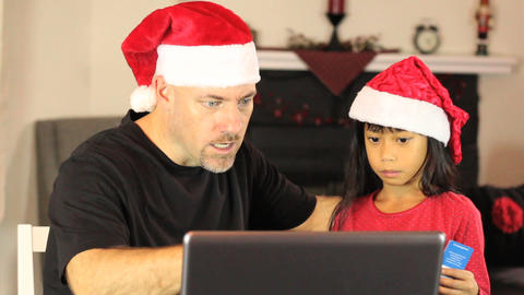 Santa And Elf Buying Christmas Gifts Online Stock Video Footage