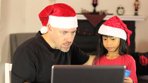 Santa And Elf Buying Christmas Gifts Online Footage
