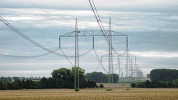 Electrical pylons with time-lapsed cloudy sky Footage