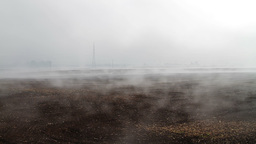 Fog crawling over cultivated meadow Stock Video Footage