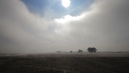 Fog crawling over cultivated meadow, wide shot Footage