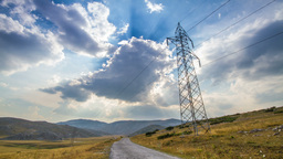 Scenery with electrical pylon and time-lapsed clou Stock Video Footage