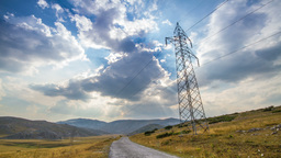 Scenery with electrical pylon and time-lapsed clou Footage
