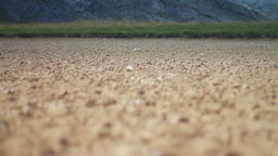 Cracked soil left by a dried out lake Footage