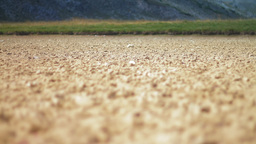 Cracked soil left by a dried out lake Stock Video Footage
