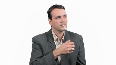 Businessman Smoking Cigarette Stock Video Footage