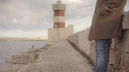 Lighthouse man standing Stock Video Footage