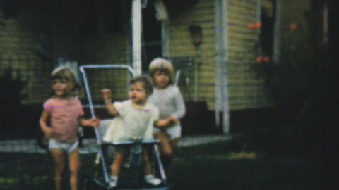 Baby Sister Fussing In Stroller In Backyard 1961 Stock Video Footage