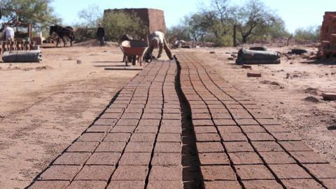 Adobe Brick Making Far Dolly Stock Video Footage