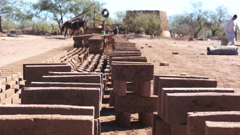 Adobe Brick Making Stacked Footage