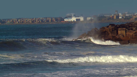 surfers riding big waves at cabo de sines in portu Stock Video Footage