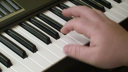 Playing piano keyboard 1 Stock Video Footage