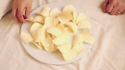 Potato chips on a dish CC Stock Video Footage