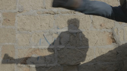 Shadow Fighting Brick Wall stock footage