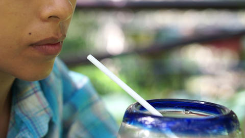 Woman drinking a Refreshment Stock Video Footage
