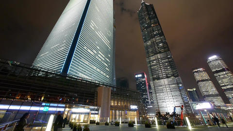 time lapse,busy pedestrian passing urban skyscraper at night Stock Video Footage