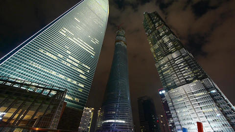 time lapse,clouds passing shanghai finance center skyscraper at night Animation