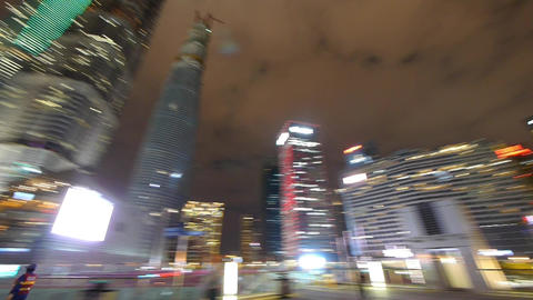 Rotating urban skyscraper with blur neon light at night Stock Video Footage