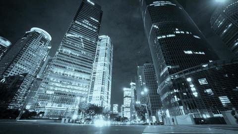 timelapse urban traffic passing skyscraper,night... Stock Video Footage