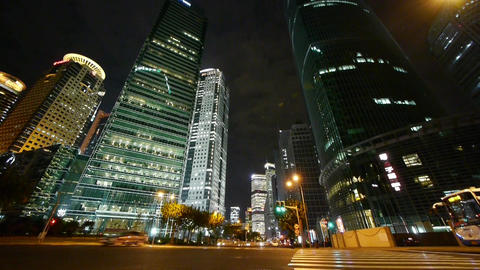 urban traffic passing skyscraper,night illuminated… Stock Video Footage