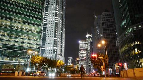 urban traffic passing skyscraper,night illuminated... Stock Video Footage